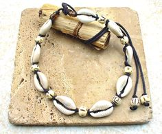 Shiny Cowrie Shell and Carved Bone Single Strand Necklace - Unisex - Unique by KipajiPraiseJewelry on Etsy