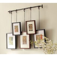 Hanging pictures - cool way to organize....