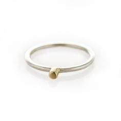 A sterling silver ring with centered small brass ball.  Please check our info page for more details on ring sizes.