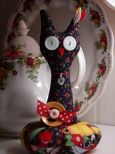 Toooooo cute!! Jubilee, handmade kitty cat pin cushion~Mary Engelbreit fabric~ by sweetmemorymakingmom, via Flickr