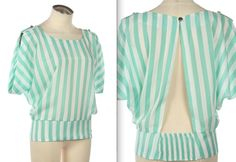 Great mint top to wear with colored denim! Coming soon!