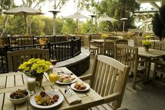Wake up to a delicous breakfast and a stunning view on the Patio at River Terrace Inn | Naples, California