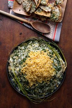 The star of this herb-flecked Persian-style rice recipe, by the actor and food blogger Naz Deravian, is the lavash tahdig — a crisp, buttery layer of toasted lavash flatbread at the bottom of the pot Break it into pieces and use it to garnish the platter of rice, making sure everyone gets a piece The rice itself is highly fragrant, scented with dill, mint and whatever other soft herbs you can get, along with heady saffron