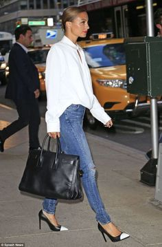Nicole Richie looks effortlessly cool in a voluminous white shirt and a denim. Fabulous.