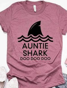 aunt shirts You won't want to go on that yacht cruise with your aunt and not have her wear this Auntie Shark Doo Doo Doo Boyfriend Tee. Even the shark will envy her. This is one gift you c Personalized T Shirts, Custom Shirts, Aunt T Shirts, Shark Shirt, Matching Shirts, Boyfriend Tee, Unisex, Shirts With Sayings, Cool Shirts