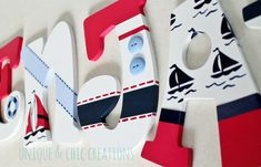 What better way to display your childs name than these adorable hand painted wooden letters? This item can be personalized to fit your design scheme. In the past, I have had clients send me pictures of nursery bedding, paint swatches or an overall image they had in mind. Then, its my job to make those images come to life! I absolutely love taking custom orders! Send me your requests today! :) The set pictured is a previously sold order, designed to fit the theme of the Regatta preppy…