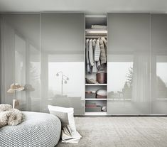 Sliding door 'Wardrobe' from Italian design brand LEMA. High gloss finish, which gives it a modern and clean look.
