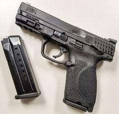 Slightly larger than the M&P Compact, the new Compact has replaced the older Compact model in Smith & Wesson's lineup. Smith And Wesson Shield, Smith N Wesson, Shooting Range, Shooting Stars, Weapon Storage, 9mm Pistol, Victoria Secret Perfume, Cabin Design, Guns And Ammo