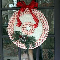 Peppermint candy wreath with ceiling medallion.
