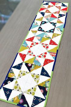 Creating quilted table runner patterns is the quickest and cutest way to dress up any dining room table or small coffee table. Check out these Free Table Runner Quilt Patterns and Table Topper Designs. Contemporary Table Runners, Modern Table Runners, Contemporary Quilts, Patchwork Table Runner, Table Runner Pattern, Quilted Table Runners, Gadgets, Charm Pack Patterns, Quilted Gifts