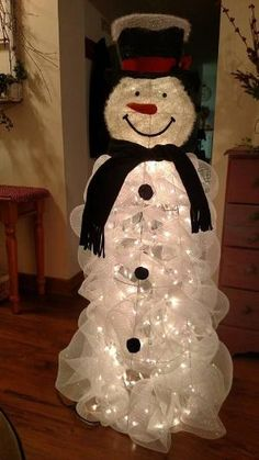 "Tomato Cage Snowman -SUPPLIES: For this snowman you will need: (2) 21""x10yd roll White Deco Mesh (1) Tomato cage - 5ft (2) White Christmas Lights 100-Light Craft Wire Wire Cutters & Scissors Snowman head which I purchased at Cracker Barrel by sheri"