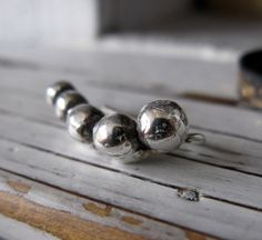 Big Balls Silver Ear Crawler by HotRoxCustomJewelry on Etsy