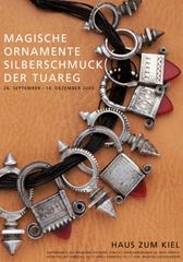 Tuareg silver jewellery |  Rings, pendants and hair adornment pieces are shown on this exhibition poster.