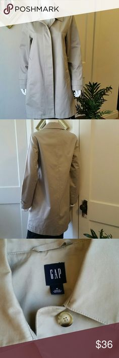 GAP Trench Coat Excellent condition lined trench with hidden buttons. Has 2 pockets and is a high quality trench that will shed water. Relaxed fit. GAP Jackets & Coats Trench Coats