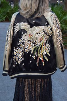 An Embroidery Bomber Jacket. This Fashion Jacket exhibits unique bold embroidered patterns with sakura flowers. Now Available at Pasa Boho