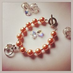 Peach coloured Swarovski beads with silver plated spacer beads and toggle clasp, with rhinestone charmHandmade in Ireland by The Crystal DenGift box available separately Pearl Beads, Pearl Necklace, Swarovski Pearls, Peach Colors, Silver Plate, Beaded Bracelets, Drop Earrings, Crystals, Den