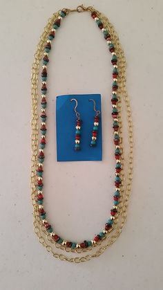 Multicolored bead and golden necklace with matching earringss