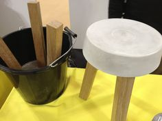 We should all be so clever. Make your own stool with concrete and a bucket.