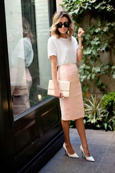 Blush pencil skirt and striped tee with messy hair and mod glasses.