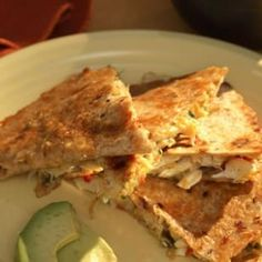 1 cup shredded reduced-fat Cheddar cheese  2 ounces reduced-fat cream cheese, softened  4 scallions, chopped  1/2 medium red bell pepper, finely chopped  1/3 cup chopped fresh cilantro  2 tablespoons chopped pickled jalapenos, (optional)  1 teaspoon freshly grated orange zest  1 tablespoon orange juice  8 ounces pasteurized crabmeat, drained if necessary  4 8-inch whole-wheat tortillas  2 teaspoons canola oil, divided