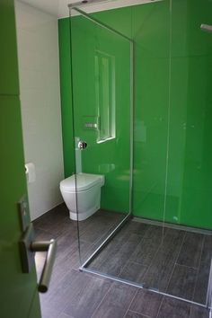 bright green back-painted glass wall. This is a terrific choice for a shower when you don't want to see a grid of tile grout lines but still need a waterproofed wall. I imagine a good installation job is crucial, though, to make sure the seams stay watertight