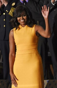 Michelle Obama shines in marigold dress at State of the Union.: Michelle Obama shines in marigold dress at State of the… Michelle Obama Fashion, Barack And Michelle, Marigold Dress, Us First Lady, American First Ladies, American Women, American History, Native American, Bright Dress