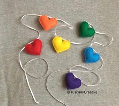 Rainbow Heart Garland in Felt. This garland measures a total of 70 inches long. It has 6 hand stitched felt hearts in rainbow colors. Each heart measures about 2 inches wide and 1 inches tall. All my products are made in a pet free, smoke free home. Paper Heart Garland, Felt Garland, Felt Christmas Ornaments, Great Christmas Gifts, Christmas Ideas, Handmade Felt, Handmade Items, Halloween Garland, Wicker Hearts