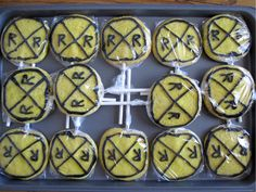 "Railroad Crossing cookie party favors for our train-themed birthday party! ""Cake Mix"" sugar cookies, Wilton cookie sticks, & Wilton Ready-To-Use Black Icing Tube! I used lemon cake mix and added some yellow food coloring to amp up the color."