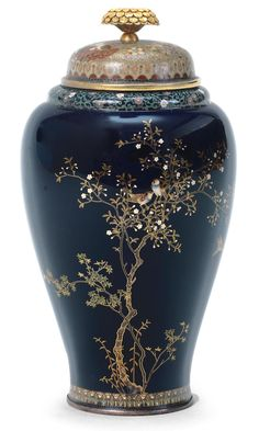 A cloisonné-enamel vessel and cover By Miwa Tomisaburo , Nagoya, Meiji era (1868-1912), late 19th/early 20th century Intricately worked in gold wire with one sparrow in flight and two perched among flowering plum branches on a midnight-blue ground. 13cm high. Bonhams 2017 - £12,500.