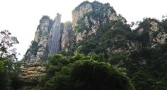 The incredible Bailong Elevator in China's Zhangjiaijie National Forest Park rises 1,070 fee up a sheer cliff.