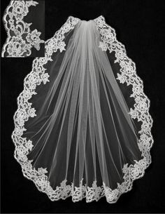 A lovely lace bridal veil with five inch wide alencon lace. It is standard cut and 36 inches by 72 inches wide, on a four inch metal comb. Because this veil is