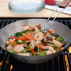 Burgers and franks? No thanks! Grill up a stir fry at your next tailgating party with this Stainless Steel Wok.