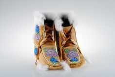 Beaded Boots by Mary Fields  Dimensions: 9.25x8.75x4.25(in) ... $650... Mary is an Athabascan Indian from Fort Yukon. She beads and smoked moose hide boots and other clothing and items.