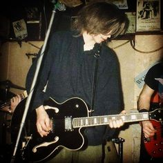 """Aah... The """"good ol' days""""... How long ago was this me on guitar? What do you think? . . #oldphoto #hollowbody #guitar #onstage #band #pub #gig #badhairday"""