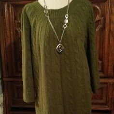 Cutest little sweater Has an olive green color with made with very soft material.. goes great with brown boots!!!! Sweaters