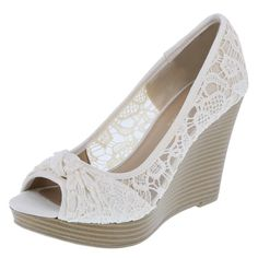 "Full of feminine flair, the Krissy Wedge from American Eagle features a crocheted upper with mesh inserts, knot detail on the toe, peep toe styling, padded insole, 4"" wedge with a 3/4"" platform, and a sturdy outsole. Manmade materials."