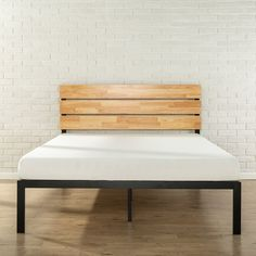 featuring a casually styled headboard and low profile metal frame this platform bed offers strong durable wood slat support for your - Lowprofilekopfteil