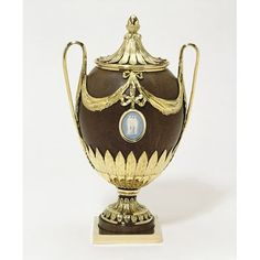 Cup and cover, Coconut, mounted in silver gilt; cover, stem and base of wood, mounted with silver gilt; the medallions of Jasper ware, 1785. V&A Museum