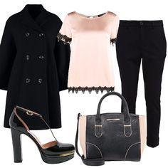 Cappotto in lana con manica ampia e abbottonatura doppia, pantalone a sigaretta e camicia in seta e pizzo. Mary jane in vernice e borsa in due colori rosa e nero.