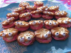 Clam cookies: Use Pepperidge Farm Lemon Cookies for the shells, canned strawberry frosting, and Wilton candy eyeballs anchored with a little royal icing.