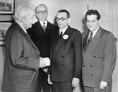 Mathematician Kurt Godel (1906-1978), receives the first Albert Einstein award for achievement in the natural sciences as physicist Julian Schwinger and Lewis Strauss look on. ca. 1951 (Photo by Everett)