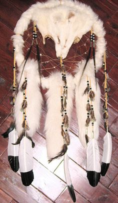 Artic fox dream catcher medicine shield with imitation eagle feathers.