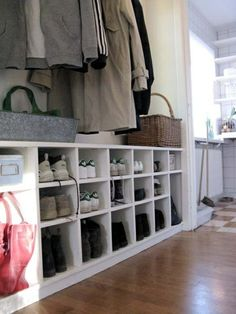 shoe board beneath the coats - looks great + good solution