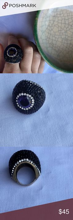 Purple Round Crystal Gemstone Ring Crystal Cocktail Ring cannot say it is 100% Swarovski because I do not have the box. It is marked 925 indicating silver type. Purple faceted stone surrounded by a row of white crystals. The entire surface of the rounded Ring is encrusted in black onyx crystals. It is a metal base body. Size 7.5. This would look amazing with a black velvet outfit!! Swarovski Jewelry Rings