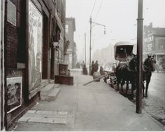 """""""Roll out the 'Barrel' When Beer Was Cheap."""" An empty cart for distributing beer in front of a bar on an unidentified street. (1900)"""