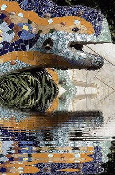 """Gaudí's multicolored mosaic salamander, popularly known as """"el drac"""" at the main entrance, as restored after the vandalism of February 2007 in park guill Barcelona"""