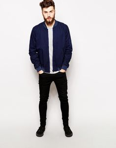 Wear a deep blue bomber jacket with black slim jeans to create a great weekend-ready look. Finish off this look with black plimsolls.