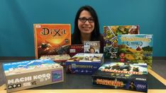 Lisa Manax Skikos, coordinator of children and youth services at the London Public Library, showcases some of the games available to be signed out as part of the new Games to Go program.