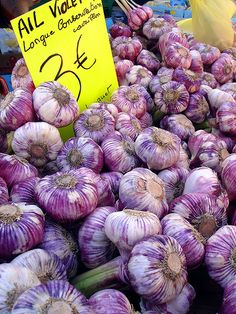 French market, heirloom purple garlic and yes, this is how they eat it.  It is not dried out