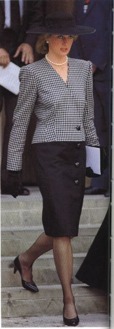 Diana in checked blazer and black skirt                                                                                                                                                                                 More